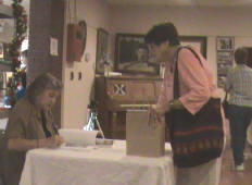 Luretta Williams, author: at book launch, signing the book.